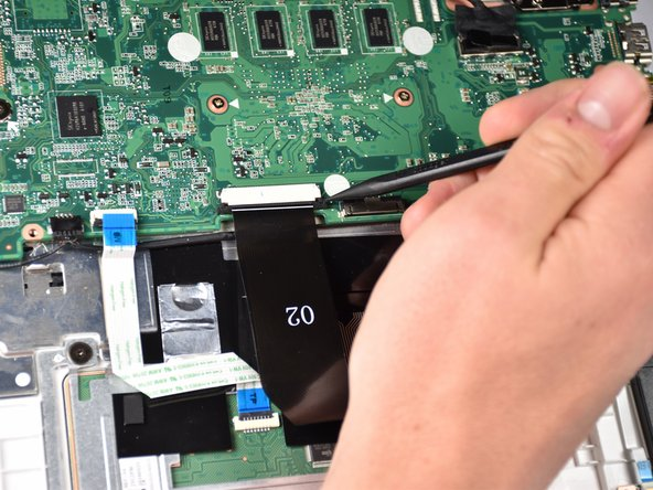 Pull out the locking mechanism of the  touchpad ZIF connector with the narrow end of the spudger.