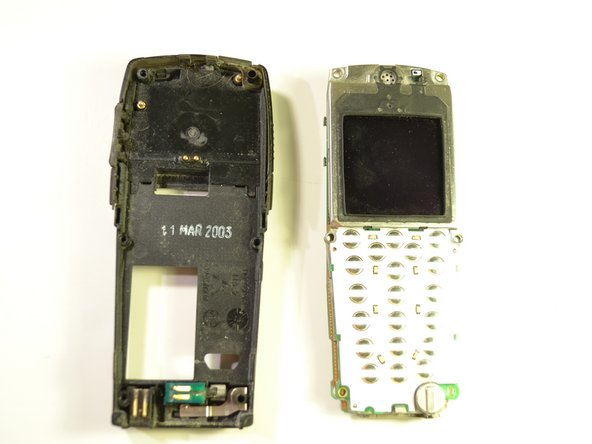Separate the inside of the phone from the back of the phone.