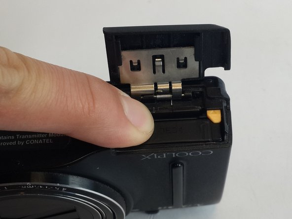 Push down on the memory card until it won't go down further. Don't push too hard to avoid damaging your camera