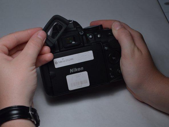 Remove the three 7mm screws around the viewfinder.