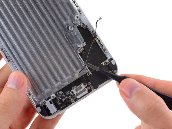 Lift and remove the antenna connector out of the iPhone.