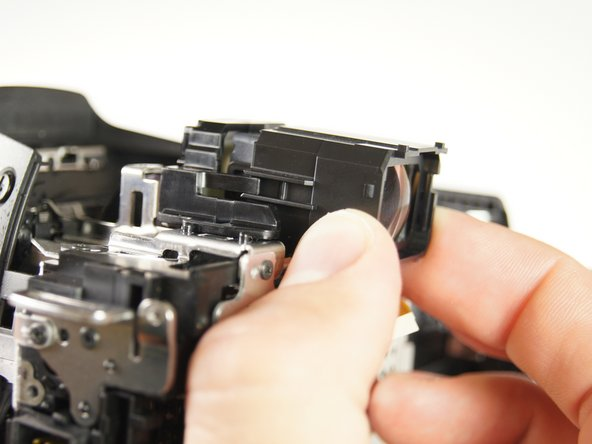 Image 1/2: Gently remove the viewfinder from the camera.