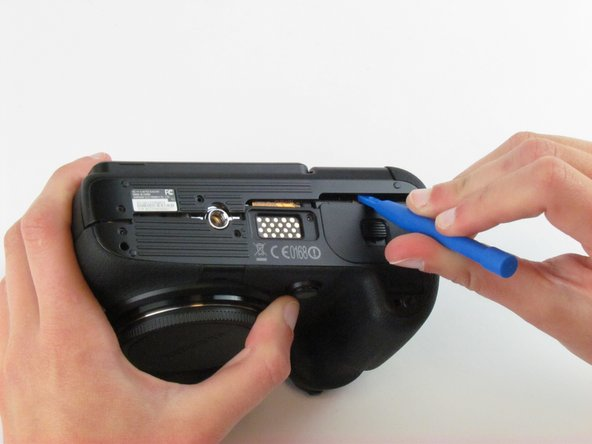 Use a plastic opening tool to separate the back cover from the front cover.