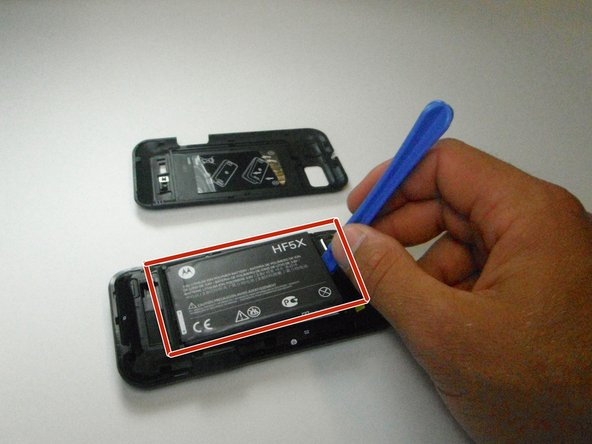 Remove the back cover and locate the battery.