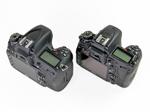 Image 2/2: Even without the different exterior markings, distinguishing the D600 from the D7000 is pretty easy once the body cap is removed, exposing the comparatively gigantic viewfinder mirror.