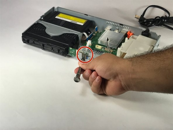 Use your Phillips screwdriver to remove the silver screw holding the Bluetooth module in place.