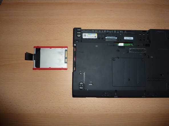 Pull on the tab firmly but slowly. The hard drive should come out of the enclosure effortlessly.