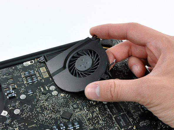 Image 3/3: Remove the left fan from the case.