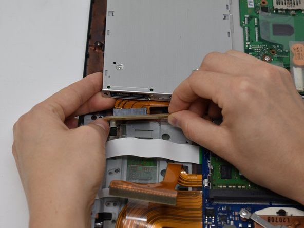 Gently remove the SATA connector from the port.