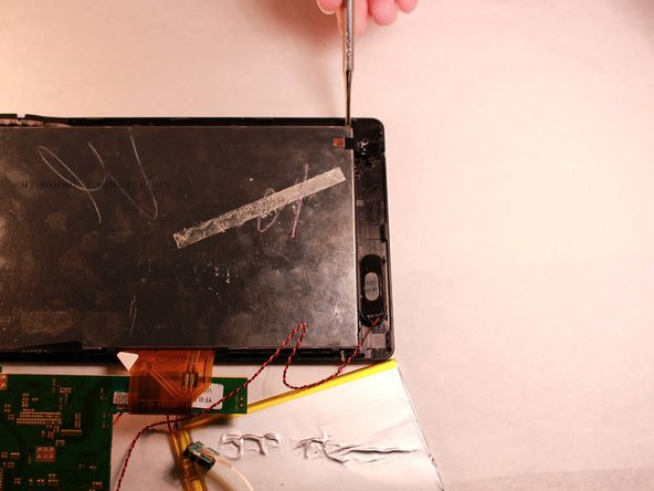 Use the Small Pointed Metal Spudger to separate the LED screen from the front screen by gently wedging the spudger between the screen and the device.