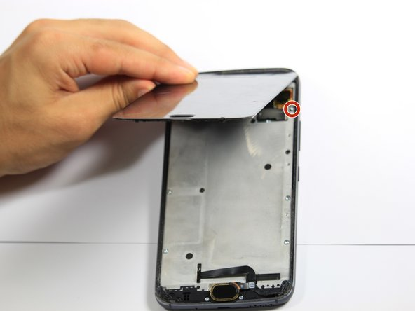 The cables at the top of the device are fragile. If you are using this guide as a prerequisite for replacing another part, be careful not to tear the cables while lifting the screen.