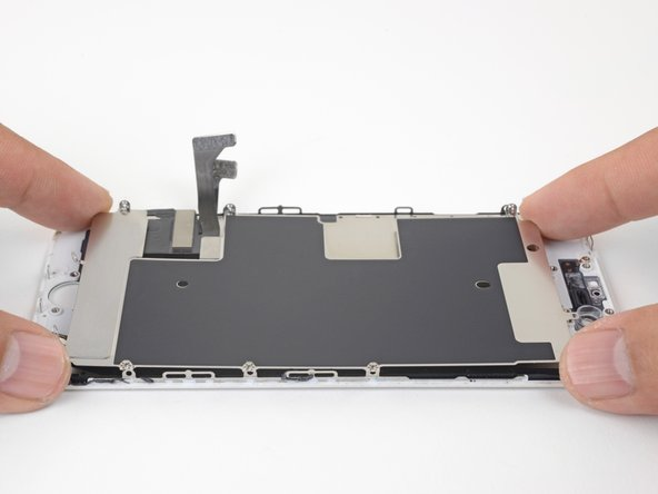 Gently lift the LCD shield plate from the display assembly.