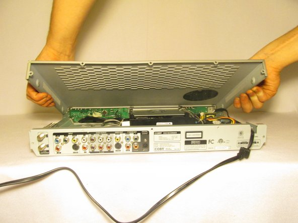 Grab underneath the sides of the DVD player and lift the front of it upwards.