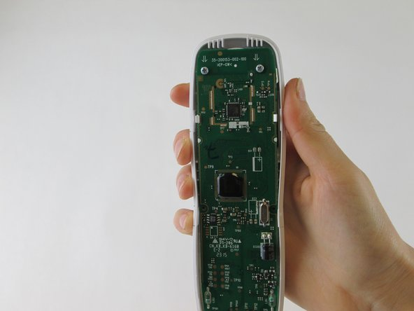 Separate the rear casing from the front by running the black spudger along the crevice on the outer edge of the phone.