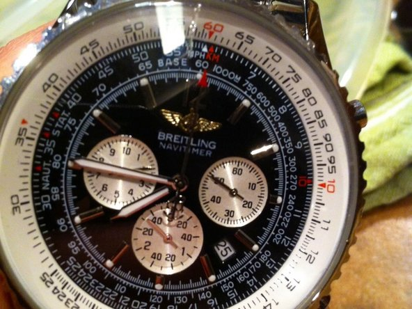NOTICE THE HORRIBLE SCRATCH ON MY BREITLING NAVITIMER AROUND THE 12 HAND, it's actually a borderline crack.