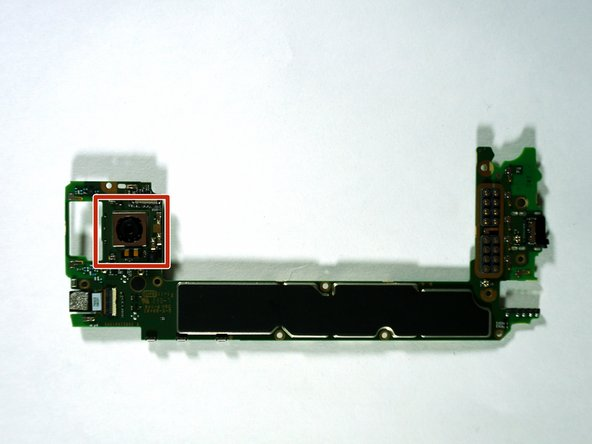 Flip over the motherboard so the rear-facing camera and its ribbon can be seen.