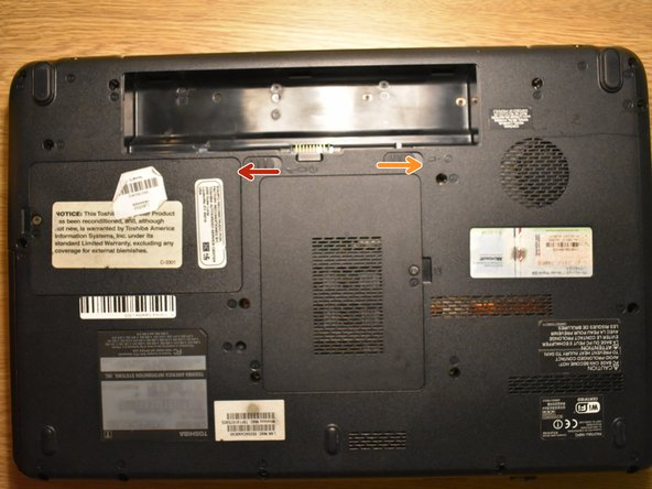 Turn your laptop upside down, at the bottom of the laptop, slide the right sliding lock to the unlocked position.