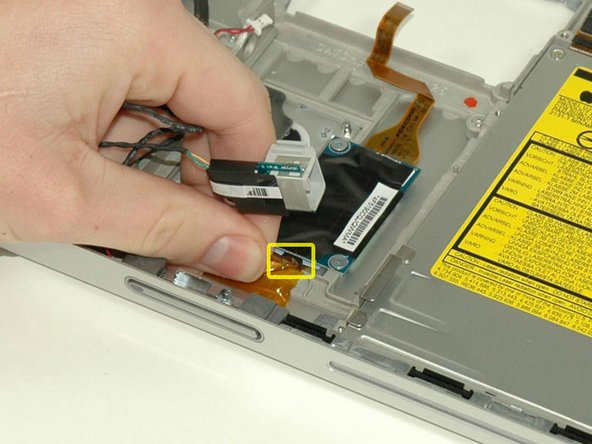 Image 1/1: Disconnect the RJ-11 cable from the bottom of the modem.
