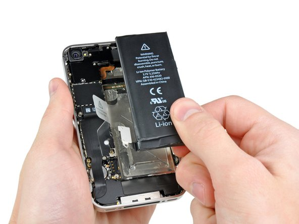 If the tab breaks before the battery is freed, carefully slide a spudger under the battery tab to release the adhesive. Prying in other places may cause damage.
