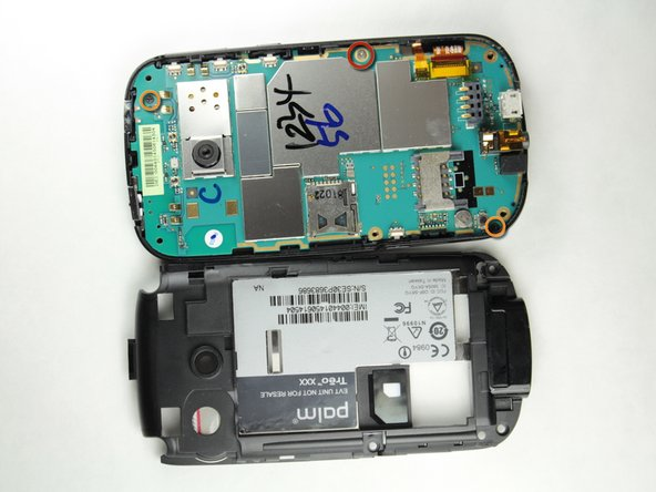 Use the Philips Head 00 screwdriver to unscrew the 3.5mm silver screw on the right hand side of the phone.