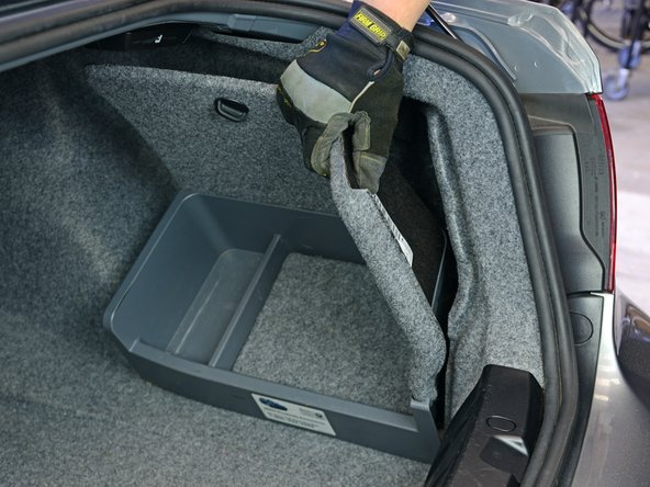 Image 2/3: On some models, the battery may be located in the trunk—usually under or behind the trunk lining. Look around or consult your owner's manual.