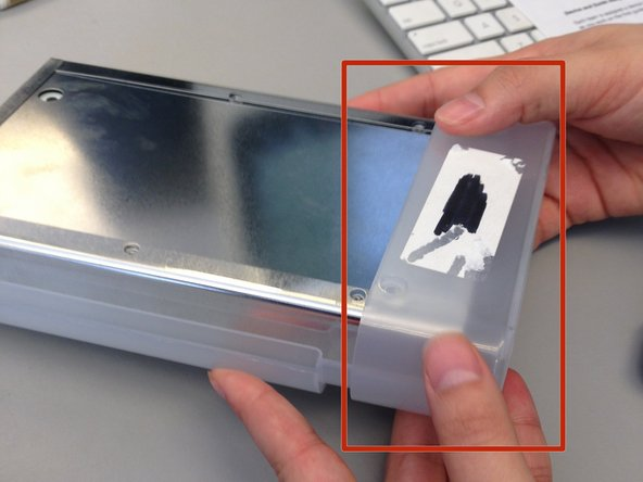 Remove the plastic end cap by sliding it forward, freeing from the rest of the device.