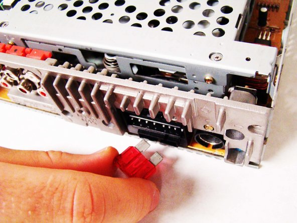 Carefully pull the fuse out of the back of the stereo.