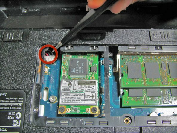 Image 1/2: After all the screws are removed, lift the motherboard up and away from the earphone jacks that are located at the front of the laptop.
