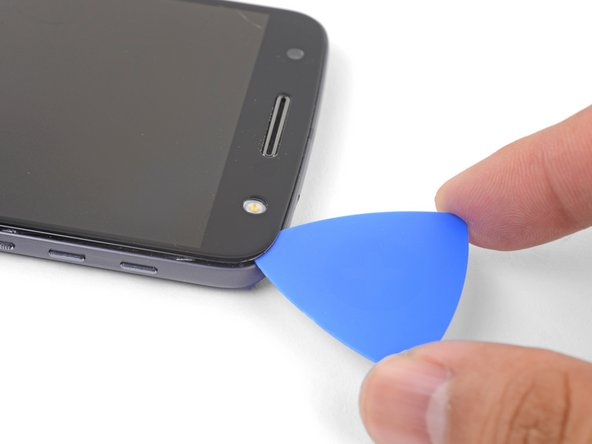 Insert an opening pick into the flash side corner of the phone and carefully slice around the flash unit.