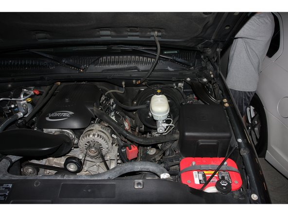 Locate your battery. It's in the  front of the engine compartment, on the drivers side.