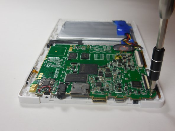 Image 3/3: Remove the motherboard by unscrewing the four 4 mm screws along the edges of the board using a Philips 00 screwdriver.