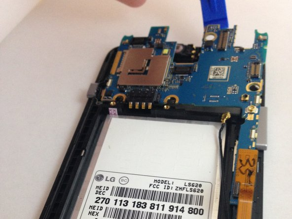 Using the plastic opening tool, carefully remove the motherboard from the phone.