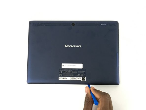Use a plastic opening tool to pry open the back cover of the tablet.