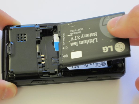 Take out the battery by levering it out towards the bottom of the phone.