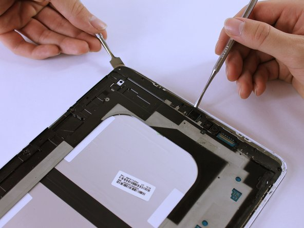 Image 1/3: On the third picture, there is a Sim Card component that is connected to the frame and back cover. As you lift up the frame, it'll detach. This is normal.