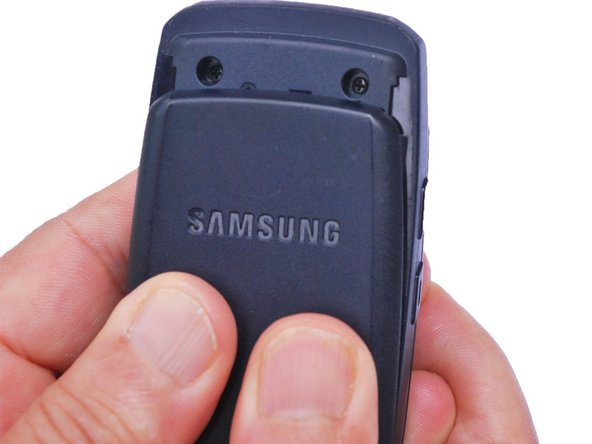 Use your thumbs to pull down on the back cover to remove it and expose the battery.
