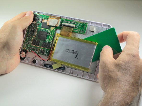 Use a plastic credit card, or other thin object, to separate the battery from the screen.
