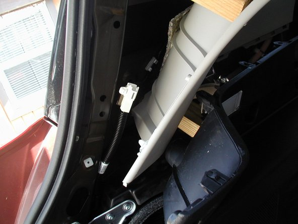 Once the side panel is free, you can see the lighting harness. Do the same on the passenger side. (NOTE:  The picture that came with the wiring instructions shows the harness being accessed by removing the small vented panels.  This is not accurate.   The harness is located up higher and behind the rear trim.)