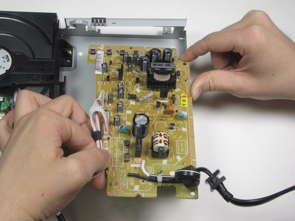 Lift the inverter board from the back end and pull toward you to complete removal.
