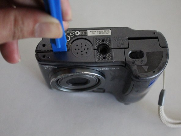Pry the outer case open using a blue, plastic opening tool.