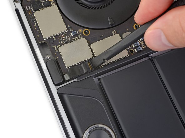 Flip open the locking flap for the left-side tweeter ZIF connector by prying it straight up from the logic board.