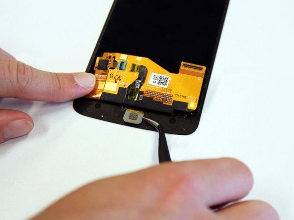 Insert the tweezers under the metal backing of the sensor.
