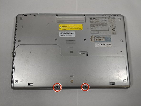 Using a #1 Phillips screwdriver, remove the two 5mm screws.