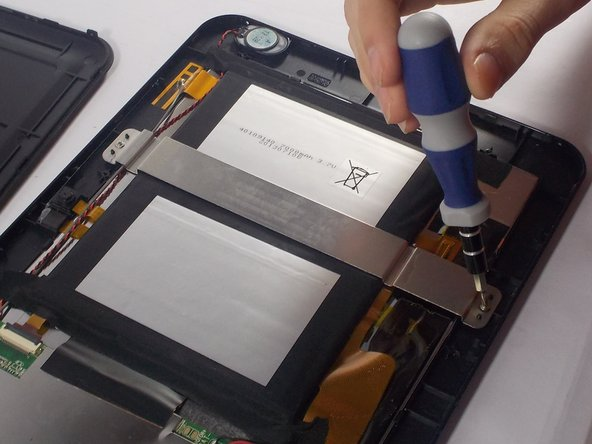 Once the electrical tape is removed there should be a metal bar across the battery.