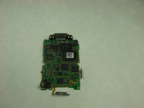 The motherboard should be completely free of the phone casing, and you should have what is shown in the pictures.