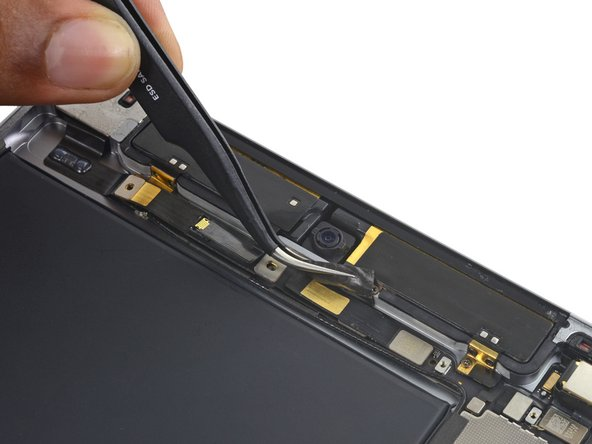 Peel up the tape over the front camera ribbon cable.