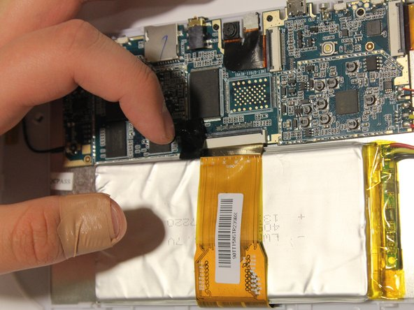 Be sure to flip up the retaining tabs before pulling the LCD connector out. (It is the black tab on the connection port).