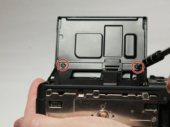 Lift the LCD screen to unscrew the 2 screws on its underside.