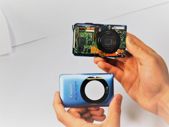 Once the front shell of the camera is removed the back shell should slide off just the same.