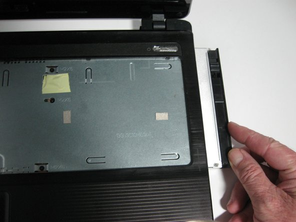 Remove the optical drive from the laptop by pulling it to the right until it has been fully detached from your laptop.